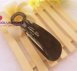 Plastic shoe horn with hotel logo